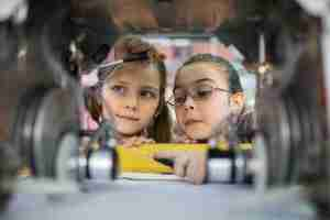 two young children building a mechanical object as part of an experiment showing you need more than just tools for innovation in the workplace to generate ideas