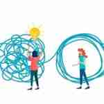 four people doing some creative problem solving to unravel a ball of string